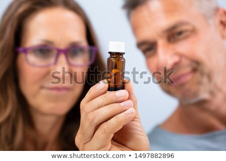 couple looking at pills bottle stock photo © andreypopov