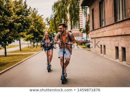Fiatalember lovaglás elektromos moped rúgás férfi Stock fotó © AndreyPopov