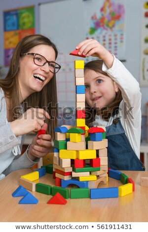 Daycare Worker Playing With Colorful Wooden Toy Blocks Stock photo © AndreyPopov