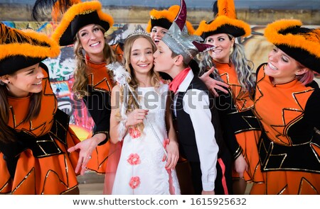 Kids as royal couple of German fasching with uniformed cheerleader dance group Stock photo © Kzenon