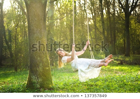 Swing giardino fiorito ragazza primavera faccia Foto d'archivio © galitskaya