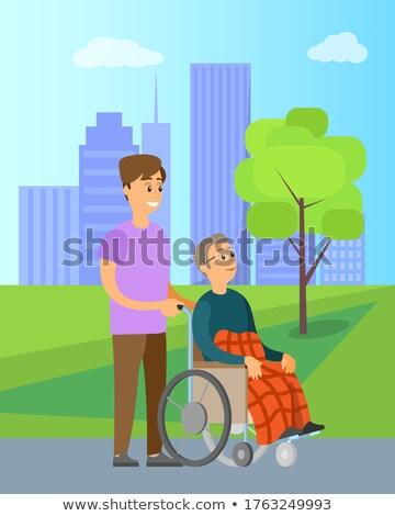 Volunteer Help Granny in Wheelchair Unable to Walk Stock photo © robuart