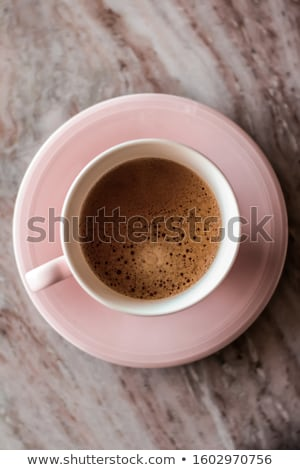 Morning coffee cup with milk on marble stone flat lay, hot drink Stock photo © Anneleven