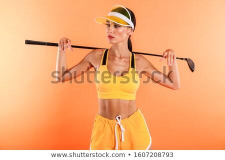 Komoly fiatal nő sport felső rövidnadrág visel Stock fotó © deandrobot