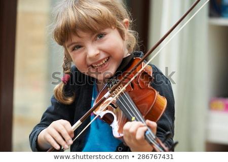 Mosolyog női hegedűművész élvezi játszik hegedű Stock fotó © Giulio_Fornasar