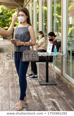 Nowego normalny kelnerka temperatura klienta Zdjęcia stock © vichie81