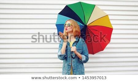 fiatal · divatos · nő · tart · esernyő · áll - stock fotó © dacasdo