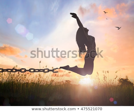girl with raised hands and broken chains stock photo © freesoulproduction