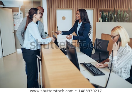 Man and woman working behind a reception desk Stock photo © photography33