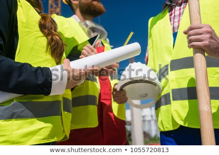 Engineer holding rolled up plans Stock photo © photography33