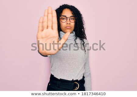 Confident woman stop gesture sing with hand stock photo © scornejor