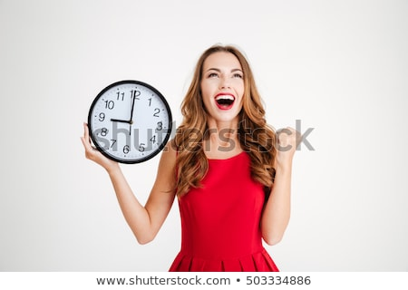 Young happy woman with a clock stock photo © scornejor