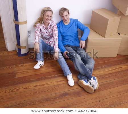 couple sat next to packed boxes stock photo © photography33