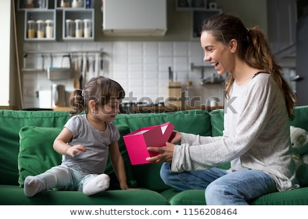Happy young kids with gift boxes in living room stock photo © get4net