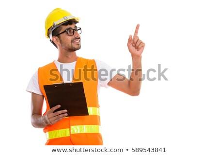 Trabajador de la construcción senalando portapapeles construcción azul sombrero Foto stock © photography33