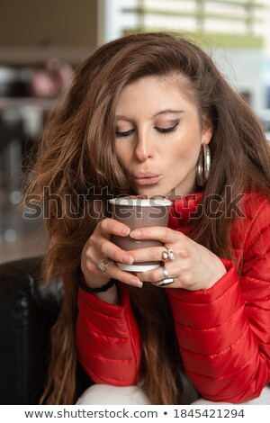 beautiful woman blow to her hot cappuccino Stock photo © Rob_Stark