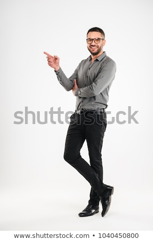 Stock photo: Casual businessman pointing