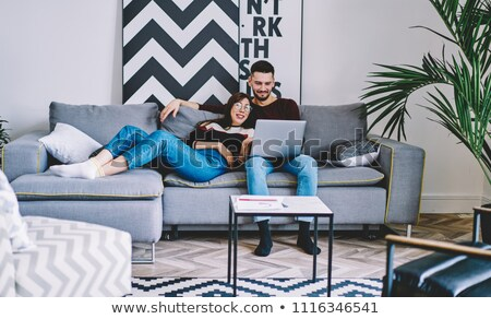 Stock photo: Couple on couch comfortably installed