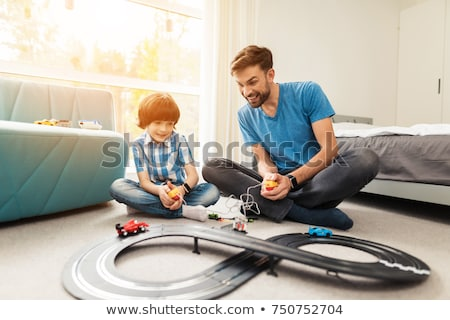 happy child playing with father stock photo © yaruta