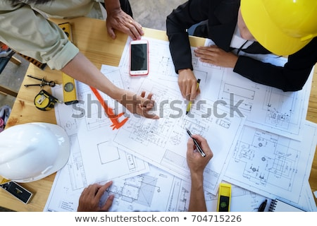 Architect at construction site with clients Stock photo © photography33