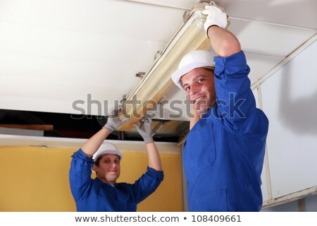 Electricians installing neon on ceiling Stock photo © photography33