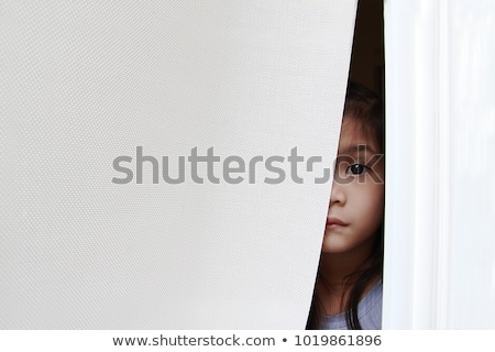 Woman spying through the blinds. Stock photo © photography33