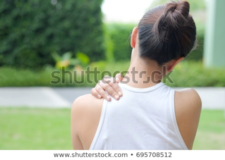 Closeup of a woman with a neckache Stock photo © photography33