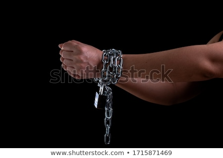 Beautiful woman with steel shackles Stock photo © pzaxe