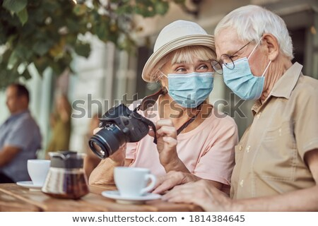 Couple at outdoor cafe Stock photo © Vg