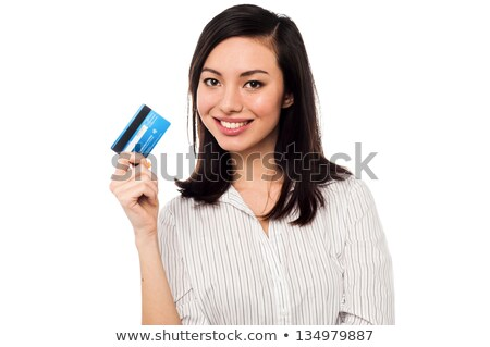 beautiful corporate woman holding credit card stock photo © stockyimages