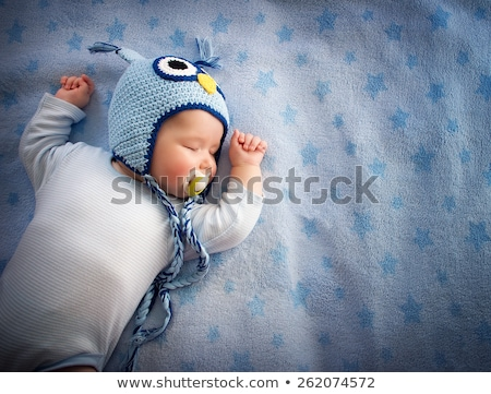 Stock photo: Adorable little baby sleeping peacefully on a blanket