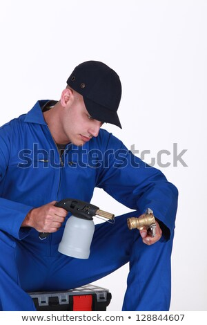 Plumber using blow torch on brass pipe Stock photo © photography33