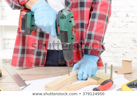 Young man with a power drill Stock photo © photography33