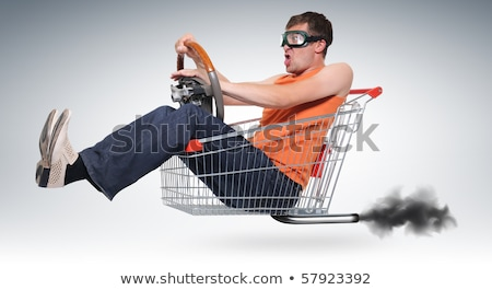 Man racing a shopping trolley Stock photo © photography33