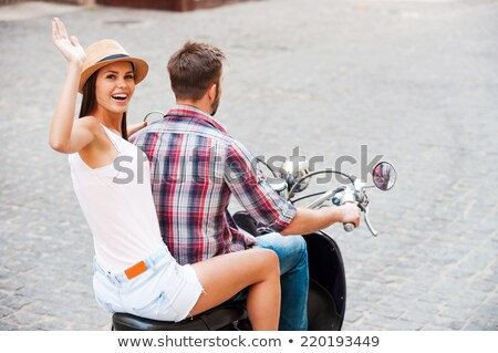 Young happy free couple in love on scooter Stock photo © Maridav