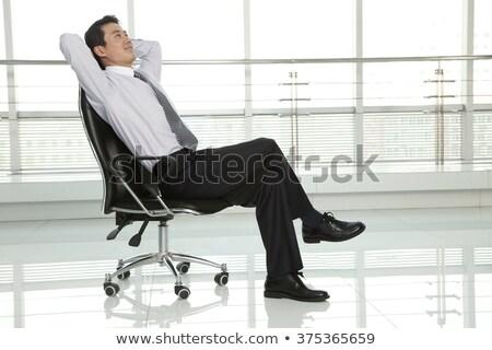 Férfi lábak keresztbe külső messze teljes alakos portré Stock fotó © feedough