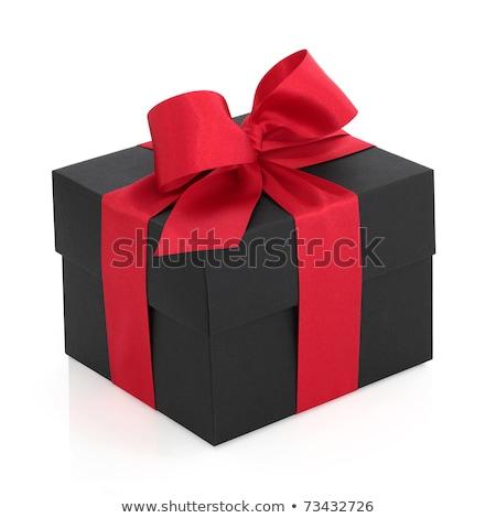 Fekete ajándék doboz piros szatén szalag íj Stock fotó © ozaiachin
