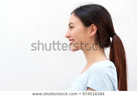 perfil · sonriendo · retrato · femenino - foto stock © iofoto