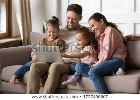 Stock photo: family of four in shop