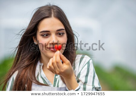 delicious strawberry fruit in woman mouth stock photo © lunamarina