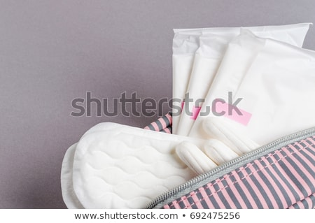 Woman in a toilet with a sanitary napkin Stock photo © Nobilior
