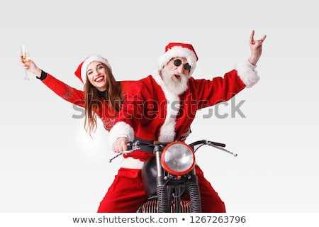 woman wearing santa claus hat and sunglasses stock photo © hasloo