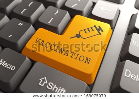 Toetsenbord vaccinatie oranje knop woord spuit Stockfoto © tashatuvango