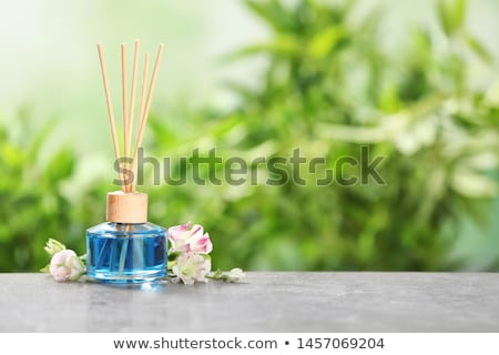Blue air freshener bottle with scented sticks Stock photo © gsermek