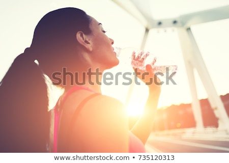 hispanic fitness model tired after sports drinking water stock photo © pxhidalgo