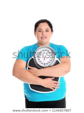 nadwaga · kobiet · skali · posiedzenia · odizolowany · biały - zdjęcia stock © mikko