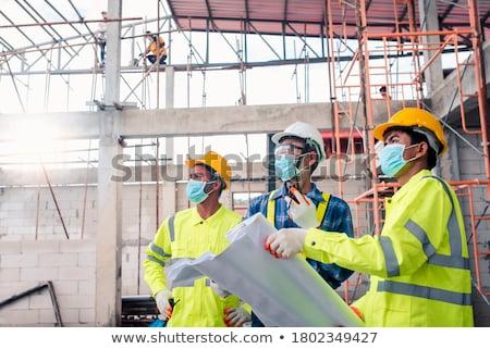 építőmunkás munkavédelmi sisak közelkép építkezés munka űr Stock fotó © jackethead