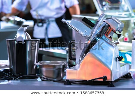 Commercial cook or chef slicing cold meat Stock photo © juniart