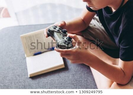 виновный · используя · ноутбук · спальня · ноутбука · мальчика - Сток-фото © monkey_business