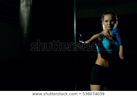 young women boxing hitting the boxing bag   on the attic stock photo © geribody